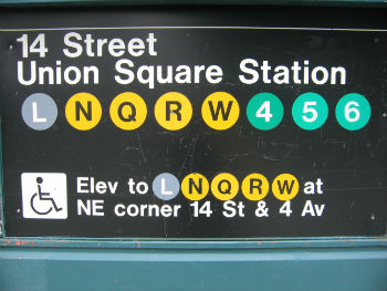 image of subway station entrance sign